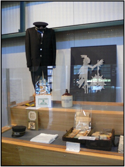 A black conductor's uniform and other objects on display at the museum.