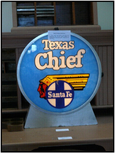 A blue drum with the words Texas Chief Santa Fe painted on it.