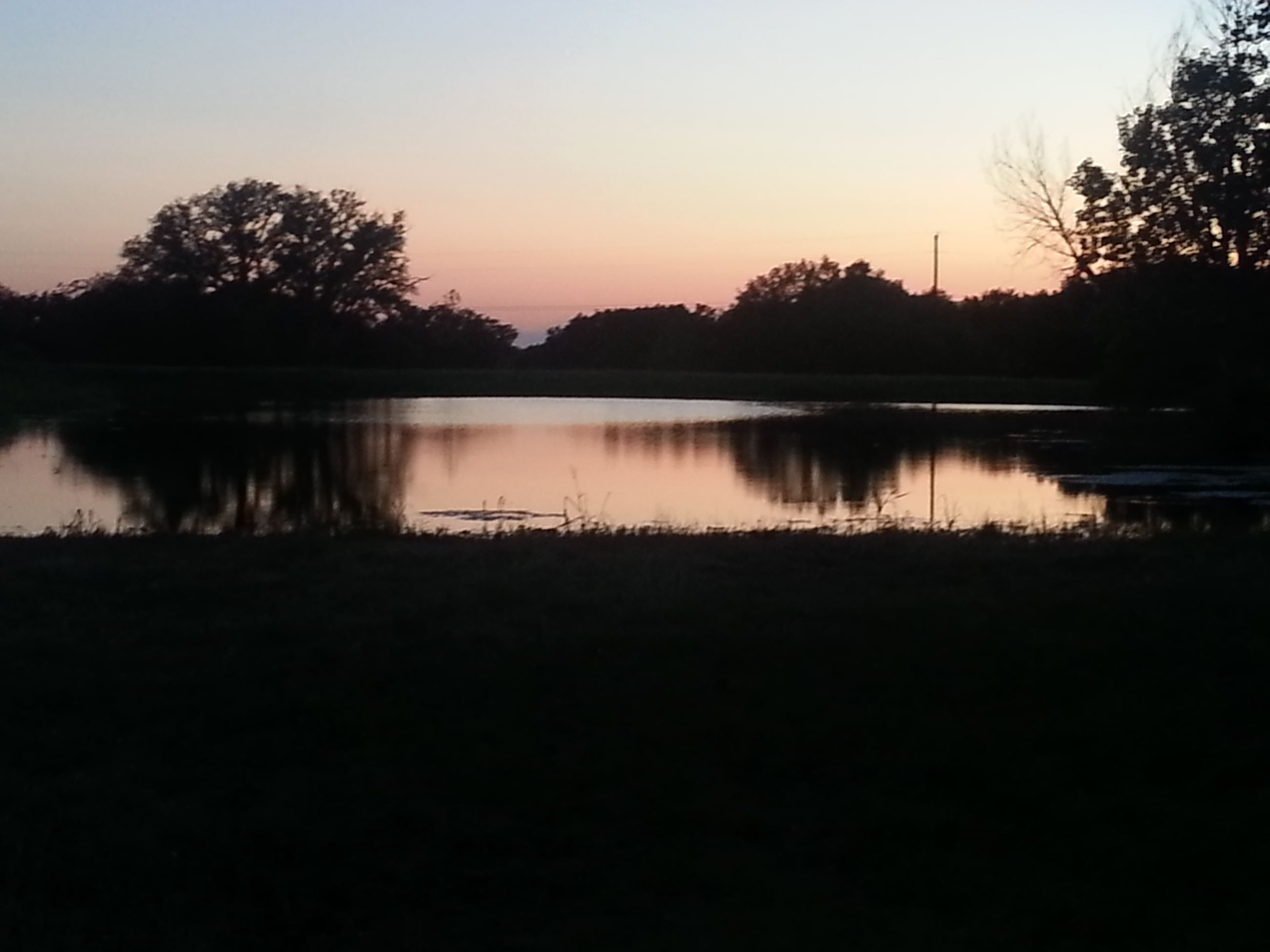 SUNSET OVER BROWNWOOD submitted by Gwen Stone
