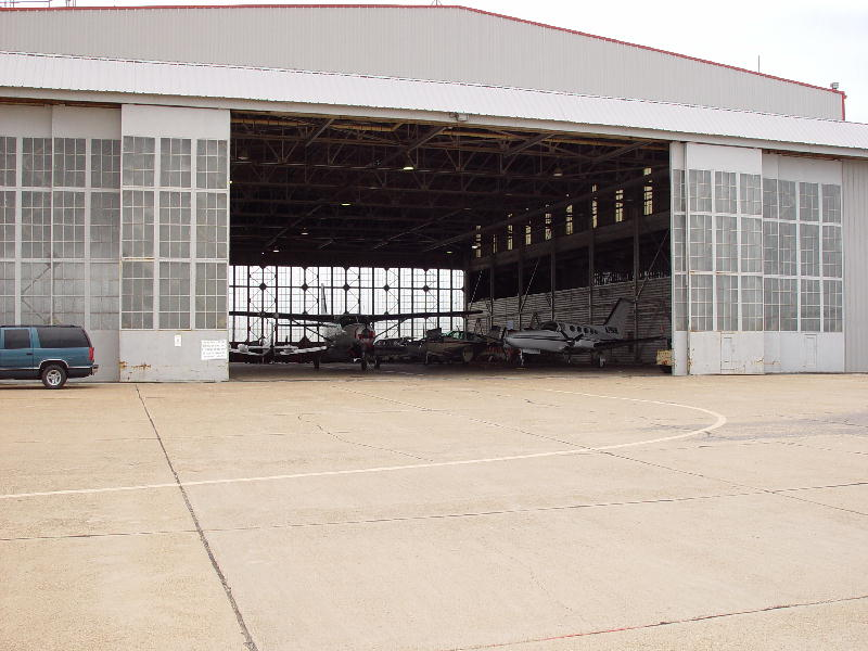 Small planes fill the airport hanger.